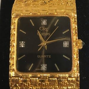 Oleg Cassini gold tone four diamond quartz  watch.